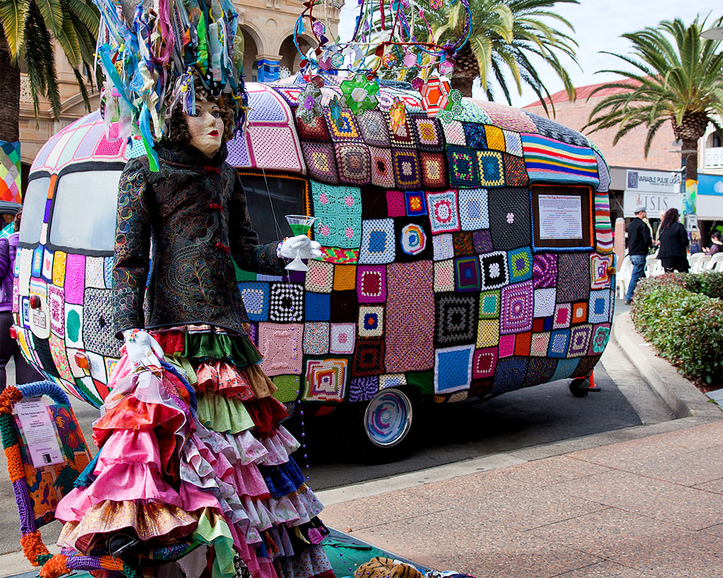 Dressed tree and handcraft covered van display
